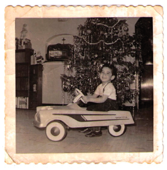 My first car, with its dazzling trim, in front of our well-trimmed tree. My outfit and hair are also in good trim.